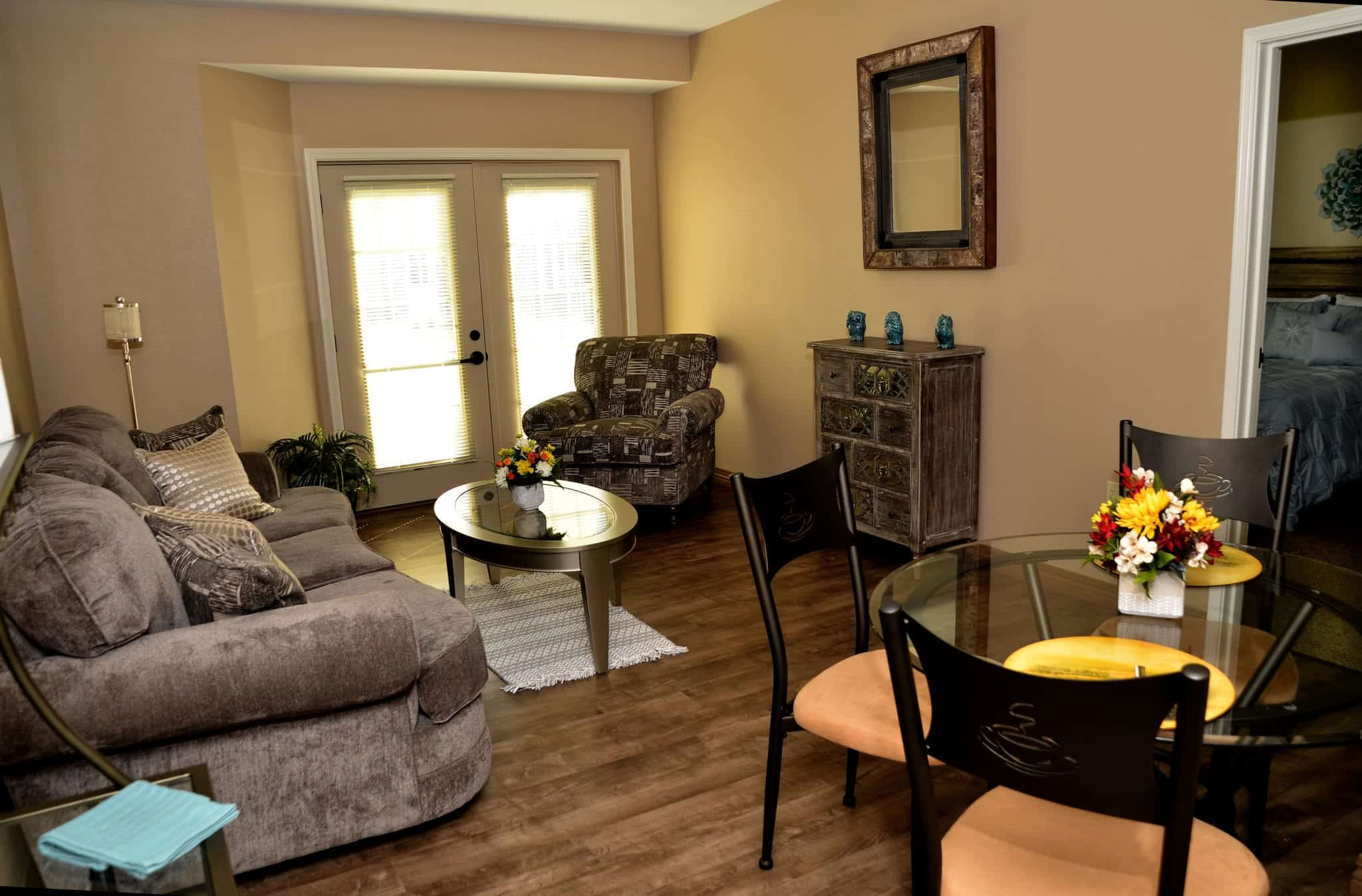 View of a living room in a large, comfortable, private assisted living apartment