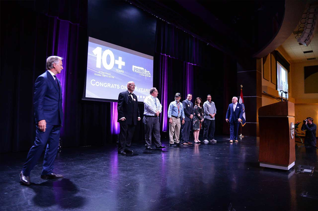 Truck drivers who've driven for Prime Inc. for 10-14 years being honored on-stage at the 10-year dinner.