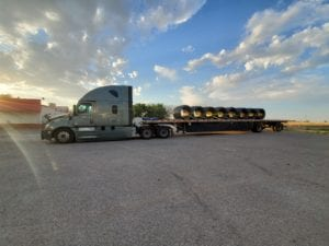 Prime Inc. Flatbed trailer with sunset in background