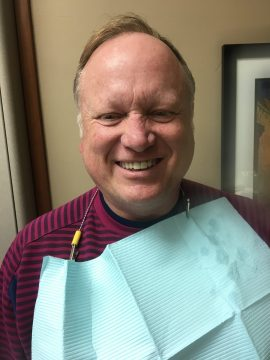 A man flashes a smile after having his dental implants installed