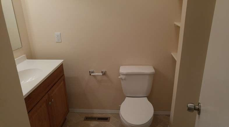 After: a modern bathroom, with new tile and a fresh coat of paint