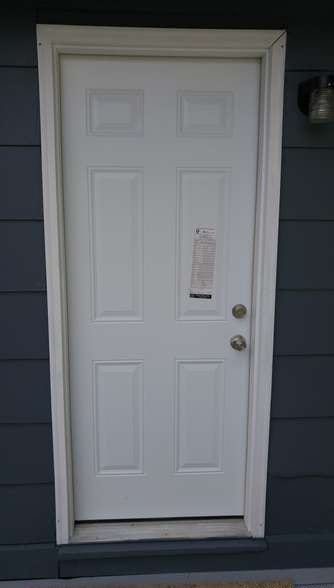 After: a new door with new siding