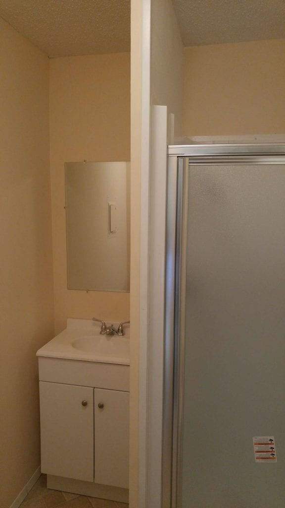 After: a modern-styled bathroom with new tile