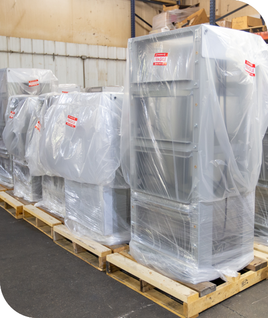 metal pieces stacked and wrapped in plastic wrap ready for assembly